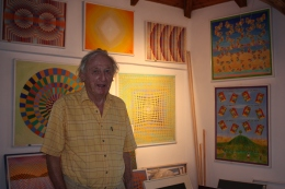 Richard Buchanon-Dunlop in his studio, with some of his paintings